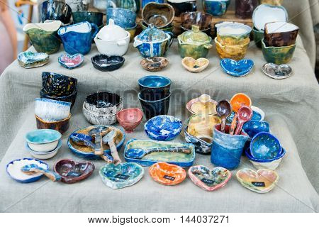 Decorative color spoons and dishes at souvenir shop at oriental marketplace