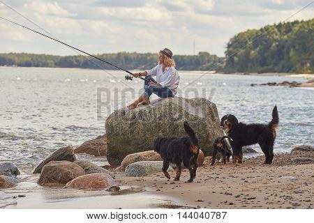 Woman Fisher Sitting
