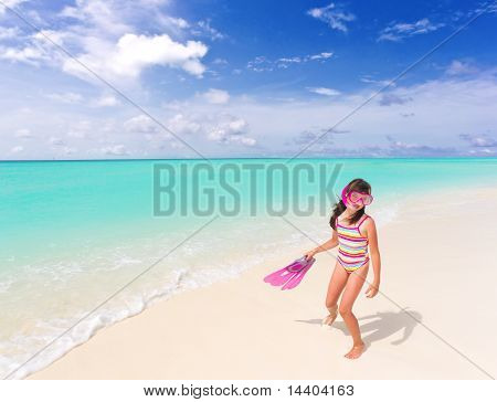 Snorkeling girl on beach