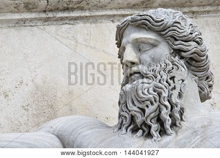 Marble head of River Nile god ancient roman statue in Capitol Square Rome