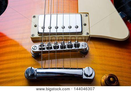 wood guitar rock close up in dark