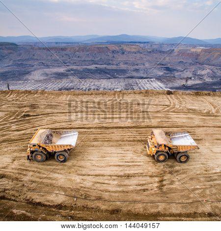 Big yellow mining trucks at a quarry