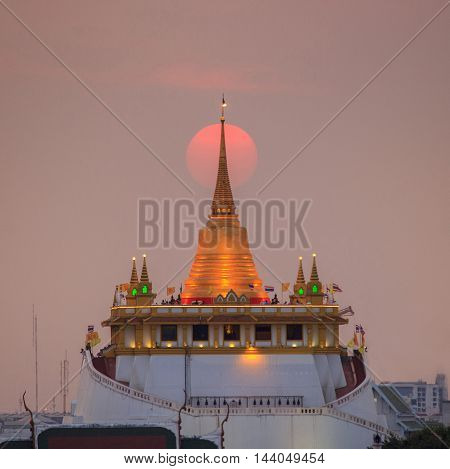 Famous Wat Saket (Golden Mount) in sunset time at BangkokThailand