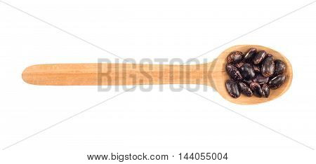 kidney beans on a wooden spoon isolated on white background