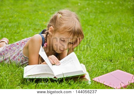 girl preparing boring lessons in nature and tired