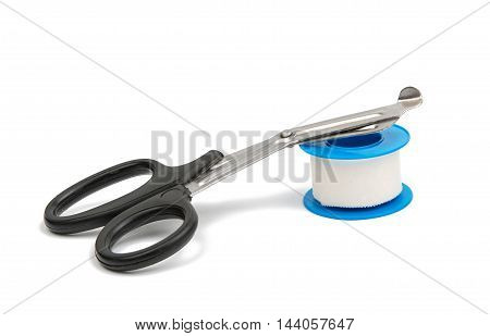 medical scissors with plaster on the white background