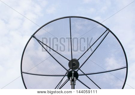 Black satellite dish with white sky background