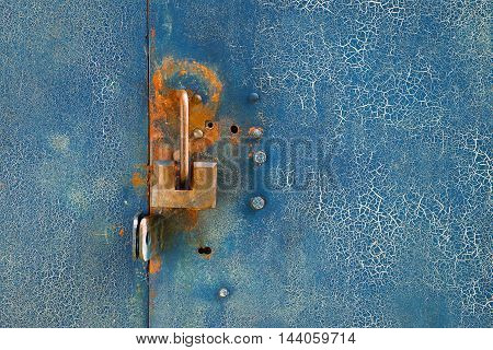 Fragment of a metal door with a lock. Texture background