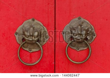 Ancient architecture and door knocker Red wooden door Chinese style