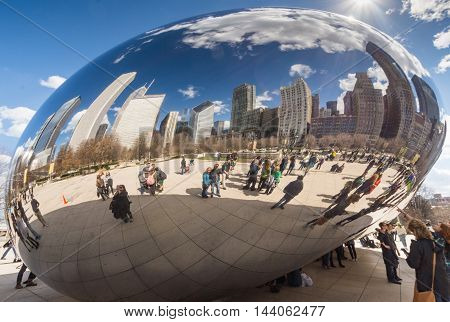 CHICAGO - MARCH 17: Cloud Gate in Millennium Park on March 17 2016 in Chicago. The Cloud Gate (bean) is a major tourist attraction in Chicago