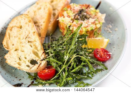 salad with salmon and vegetables isolated on white background