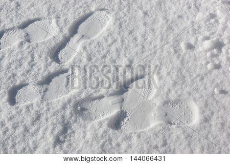 Snow texture with foot prints, winter background