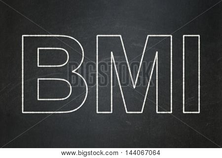 Health concept: text BMI on Black chalkboard background