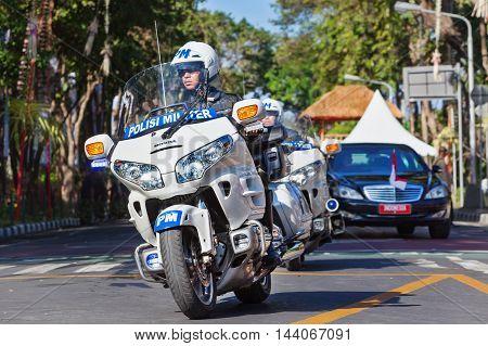 DENPASAR BALI ISLAND INDONESIA - JUNE 11 2016: President Indonesia Joko Widodo ( Jokowi ) motorcade with military police motorbike escort at Denpasar streets during official visit to Bali
