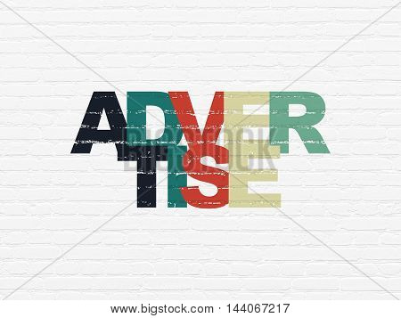 Advertising concept: Painted multicolor text Advertise on White Brick wall background