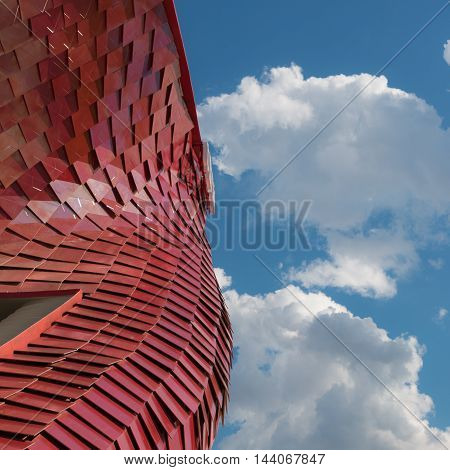 MILANO, ITALY - MAY 2015: Detail of Futuristic Megastructure: Curve Red Building Facade at Exposition in Milan - Italy