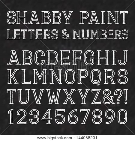 White capital letters and numbers of shabby paint on a black marble surface. Outline font with cracks. Type in grunge style. Isolated alphabet.