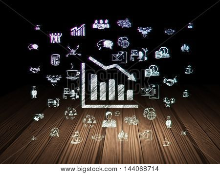 Business concept: Glowing Decline Graph icon in grunge dark room with Wooden Floor, black background with  Hand Drawn Business Icons