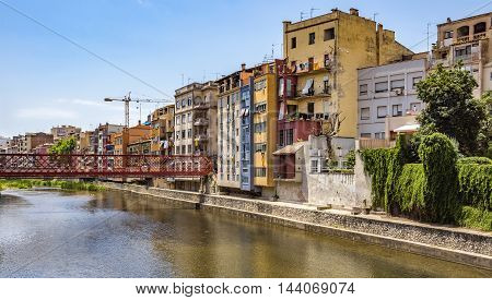 GIRONA SPAIN - JULY 6 2016: Colorful houses against sky in Girona Catalonia Spain