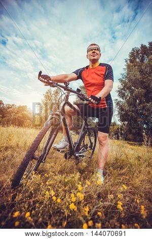 Mountain biking - man with bike enjoy summer vacation