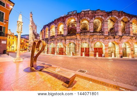 Verona, Italy - May 22, 2016: Ancient roman amphitheatre with modern metal bench in form of heart on Bra square in Verona city. Verona is city of love