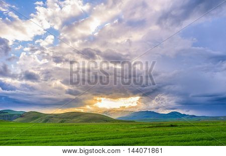 The bright hole in the grey cloudy sky looks like gateway to heaven open over the highlands Syunic Province Armenia.
