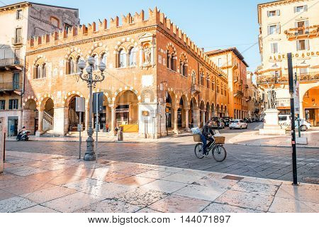 Verona, Italy - May 22, 2016: Morning life in the central square Erbe in Verona old town. City without tourists early in the morning