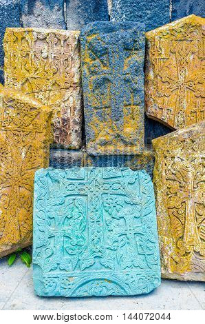 The khachkars are famous Armenian cross-stones covered with different complex patterns and used as the tombstones or memorial signs Sevanavank Monastery Sevan Armenia.