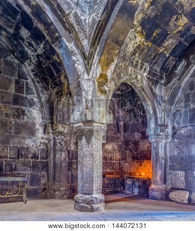 HAYRAVANK ARMENIA - MAY 31 2016: The dark stone gavit (frontage hall) in Church of Hayravank Monastery is supported by columns on May 31 in Hayravank.