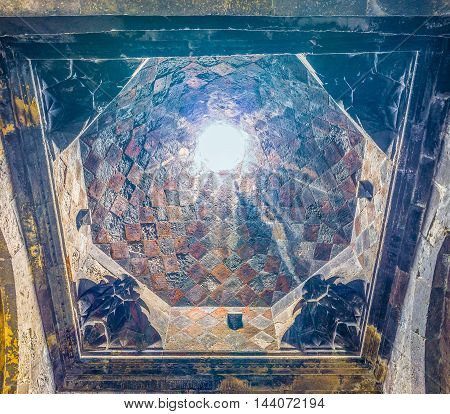 HAYRAVANK ARMENIA - MAY 31 2016: The cupola in Church of Hayravank Monastery decorated with stone mosaic and carvings on May 31 in Hayravank.