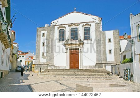 CASCAIS PORTUGAL - MAY 1 2012: The Church of Our Lady of Mercy located in Misericordia street in maze of the old town on May 1 in Cascais.