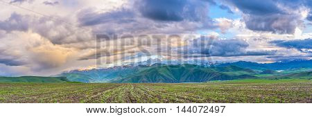 The rainy clouds at sunset look amazing changing their color every minute Syunik Province Armenia.