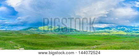 The rainy clouds in highland change their direction and location very fast Syunik Province Armenia.