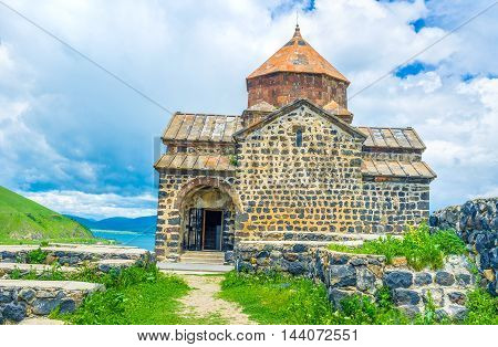 The interesting medieval religious architecture preserved examples of art and amazing nature of Sevan Lake attracts tourists to Sevanavank Monastery Armenia.