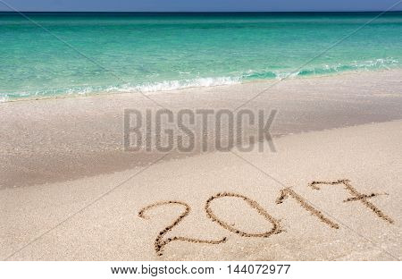 The inscription on the sand of the sea in 2017 a concept - the beginning of the new year