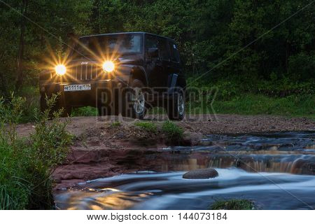 Leningrad region, Russia , August 25, 2016 , Jeep Wrangler on the banks of the river Tosno in the Leningrad region, the Jeep Wrangler is a compact four wheel drive off road and sport utility vehicle
