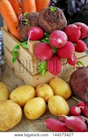 Wooden crate with fresh vegetables, closeup