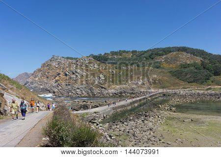 VIGO, SPAIN - AUGUST 18, 2016: Tourist on the Middle Island of the Cies Islands Natural Park. The Cies Islands are an archipelago off the coast of Vigo in the mouth of the Ria de Vigo.