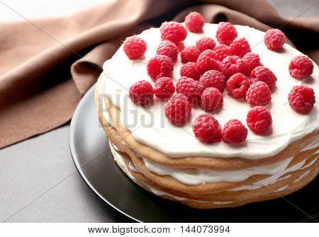 Tasty raspberry cake on plate, closeup