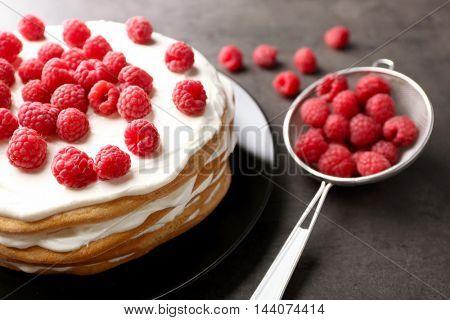 Tasty raspberry cake on grey background, closeup