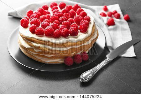 Tasty raspberry cake on grey background