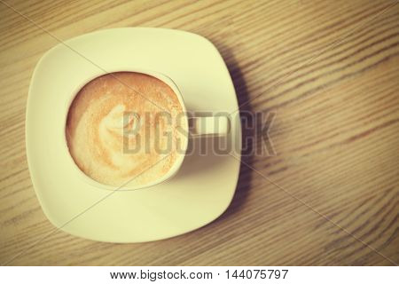 Cup of fresh coffee on the table