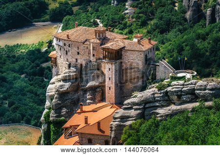 Mountain scenery with Meteora rocks and Roussanou Monastery landscape place of monasteries on the rocks orthodox religious greek landmark in Thessaly Meteora Greece