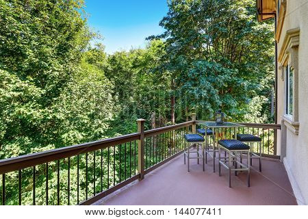 Second Floor Balcony With Outdoor Table And Chair Set