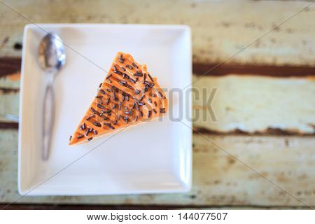 close up of a cream cake on wooden table