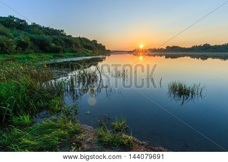 Scenic View Of Beautiful Sunset Above The River At Summer