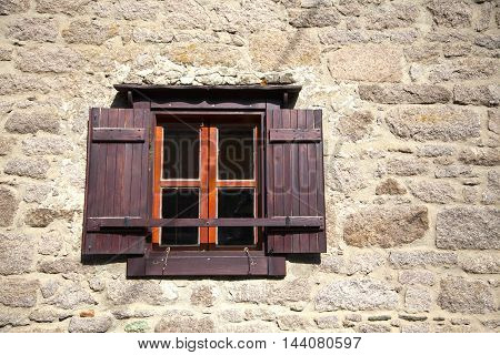 beautiful window of the old stone house.