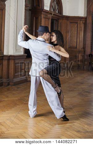 Tango Dancers Performing In Restaurant