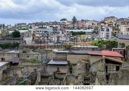 Herculaneum Italy - June 10: Herculaneum archeological site on June 10 2016 in Herculaneum Italy. The ruins of Herculaneum excavation in front and view of the