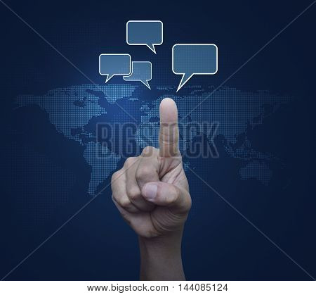 Hand point to social chat sign and speech bubbles over digital world map blue background Social network concept Elements of this image furnished by NASA